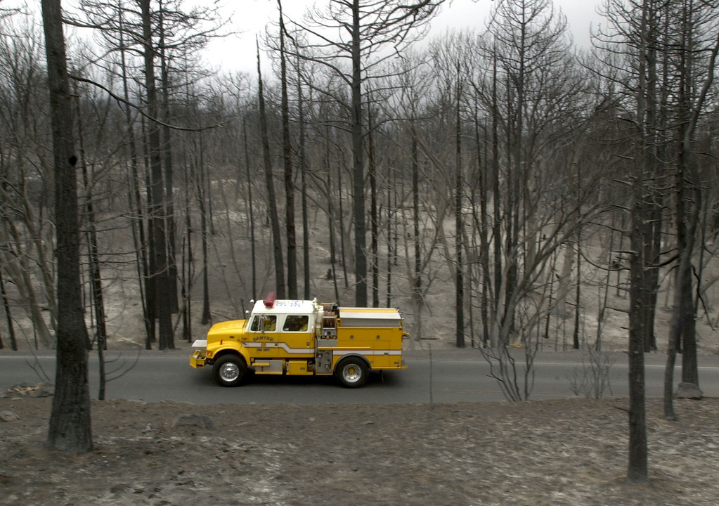 . A firetruck passes through a charred region of of the Cuyamaca Rancho State Park Friday, Oct. 31, 2003 near Cuyamaca, Calif. More than 272,000 acres have burned so far in the Cedar fire east of San Diego . (AP Photo/Charlie Riedel)