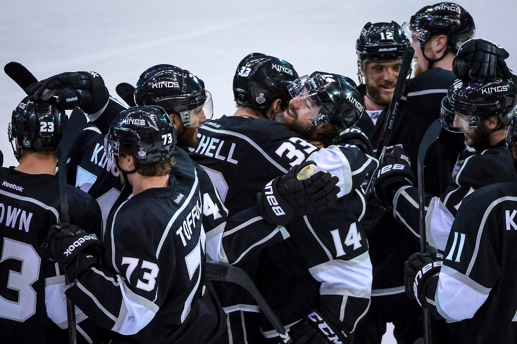 . Teammates swarm Justin Williams, 14, after he scored the winning goal in overtime during Game 1 of the Stanley cup Finals at Staples Center Wednesday, June 4, 2014  Kings won the game  3-2.   ( Photo by David Crane/Los Angeles Daily News )