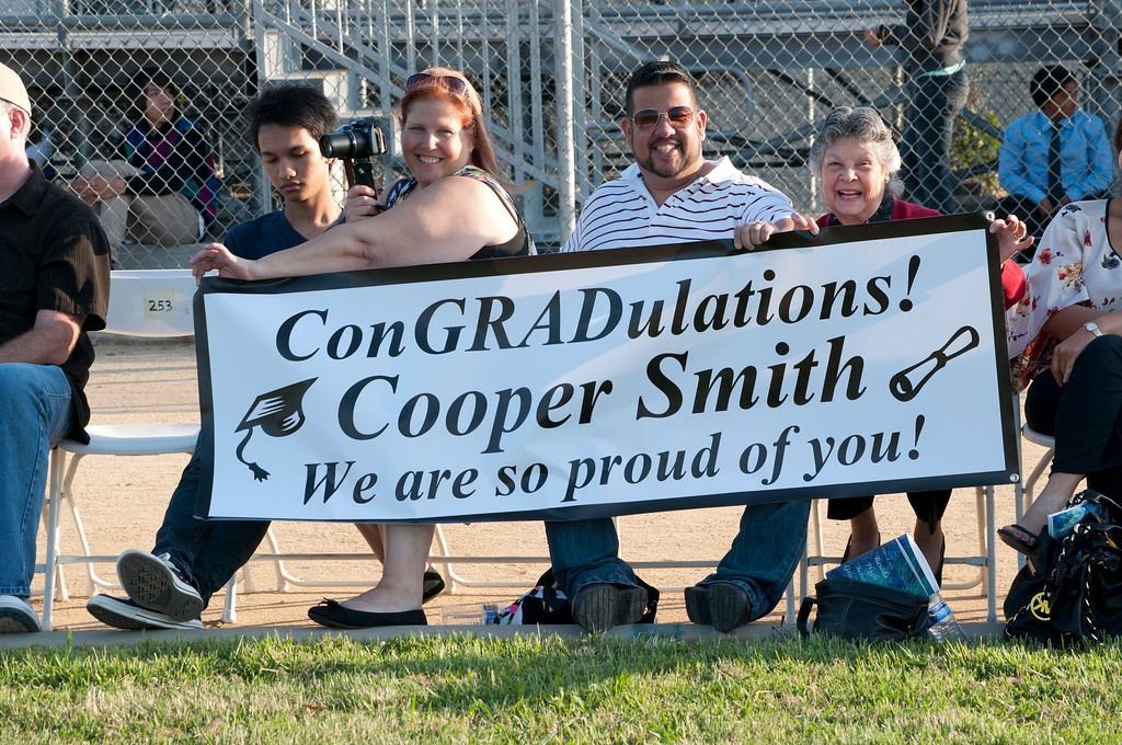 . Family members proudly display a banner during the graduating ceremony.   The Reseda High School graduation class held their commencement in the school football field on Friday,  June 07, 2013 in Reseda, CA.   Photo by Carlos Carpio