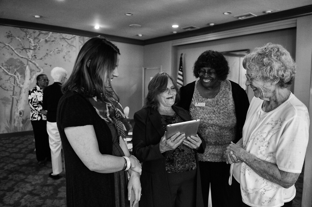 . Dorothy shows pictures of her new life on her iPad before speaking to the Council of Women\'s Club Pasadena.