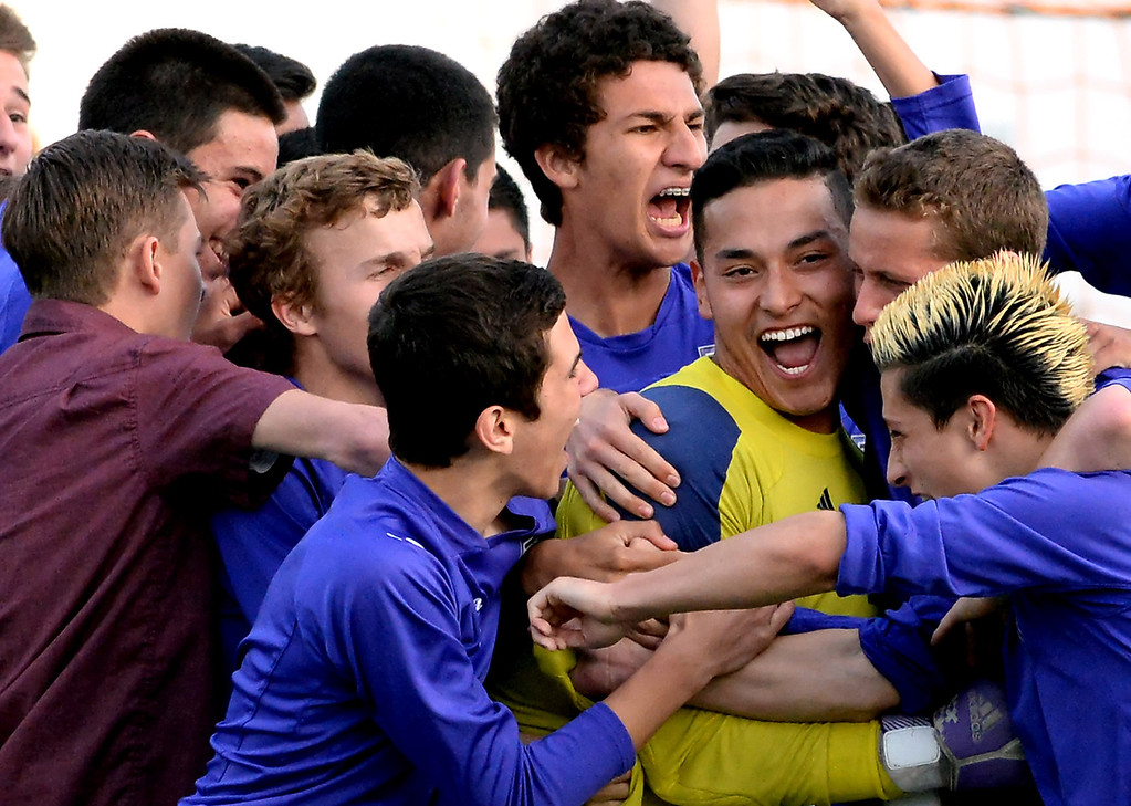. Diamond Bar goal keeper Manny Perez, center, is mobbed by teammates as they defeated Monrovia 3-2 after regulation play and two over-times during a second round soccer match at Monrovia High School in Monrovia, Calif., on Tuesday, Feb.25, 2014.  (Keith Birmingham Pasadena Star-News)