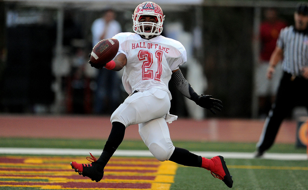 . Eest\'s Aaron Vaughns (21) (Charter Oak) runs for a 54 years touchdown in the first half of the annual East vs. West San Gabriel Valley Hall of Fame all-star football game at West Covina High School on Friday, May 17, 2013 in West Covina, Calif.  (Keith Birmingham Pasadena Star-News)