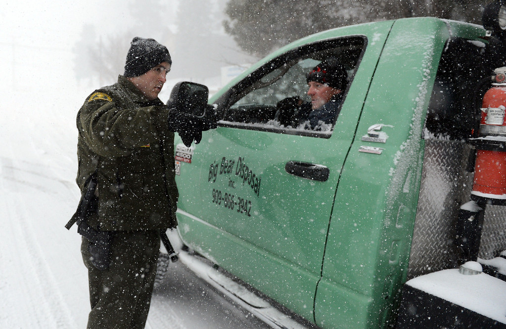 . San Bernardino County Sheriff deputies along with other law enforcement agencies continue the manhunt for Christopher Jordan Dorner Friday February 8, 2013 near Bear Mountain in Big Bear.(Staff photo by Will Lester/Inland Valley Daily Bulletin)