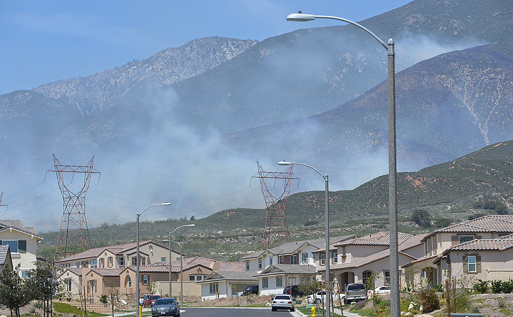 . Smoke from the Etiwanda Fire can be seen to the west and  above Woodley Ridge Drive in Rancho Cucamonga. Driven by fierce winds the fire has grown to about 800 acres, threatening homes and forcing some residents to evacuate. (Photo by Rick Sforza/Inland Valley Daily Bulletin)