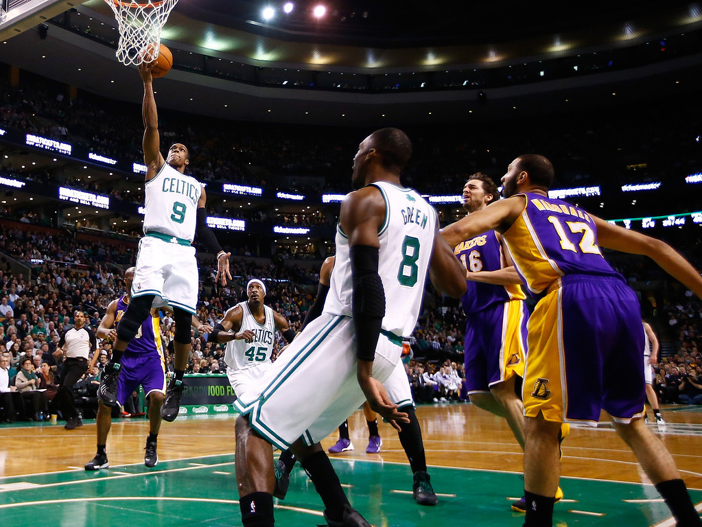 . BOSTON, MA - JANUARY 17: Rajon Rondo #9 of the Boston Celtics goes up for a layup against the Los Angeles Lakers in the second quarter during the game at TD Garden on January 17, 2014 in Boston, Massachusetts.   (Photo by Jared Wickerham/Getty Images)