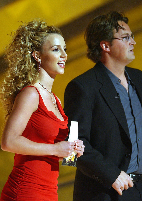 . Britney Spears and Matthew Perry present the award for best pop performance by a duo or group during the 44th annual Grammy Awards, Wednesday, Feb. 27, 2002, in Los Angeles. (AP Photo/Kevork Djansezian)