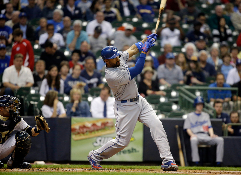 . Los Angeles Dodgers\' Matt Kemp hits an RBI single during the first inning of a baseball game against the Milwaukee Brewers Wednesday, May 22, 2013, in Milwaukee. (AP Photo/Morry Gash)