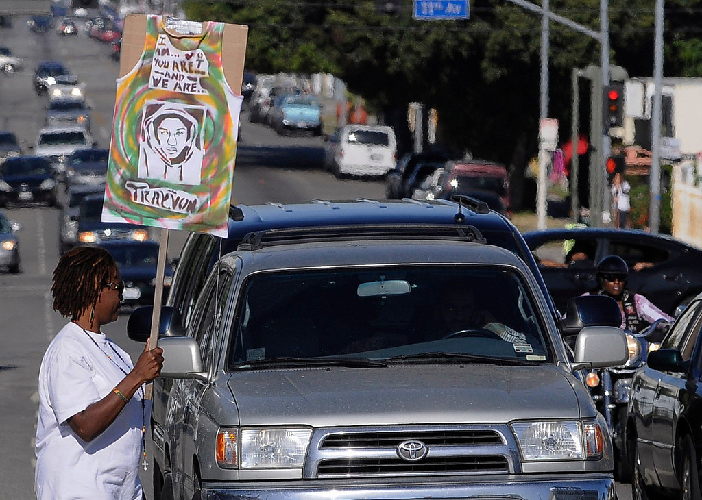 . A woman walks out onto Vernon Ave. during the protest. Crowds gather to protest while a heavy presence of Los Angeles Police Officers patrols the area around Leimert Park at the intersection of, Crenshaw Boulevard and Vernon in Los Angeles, CA. 7/16/2013(John McCoy/LA Daily News)