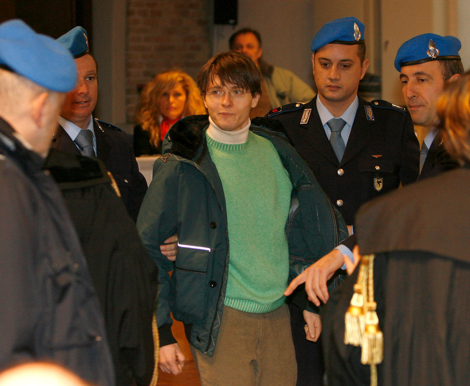 . Raffaele Sollecito, center, is escorted by Penitentiary guards arrives at Perugia\'s court, Italy, Friday, Jan. 16, 2009. (AP Photo/Alessandra Tarantino)