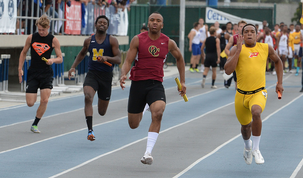 . Paraclete\'s Triston Brown, right, along with Oaks Christian\'s Jordan Anderson runs the final leg of the division 4 4x100 meter race as Paraclete won the race during the CIF Southern Section track and final Championships at Cerritos College in Norwalk, Calif., Saturday, May 24, 2014. 