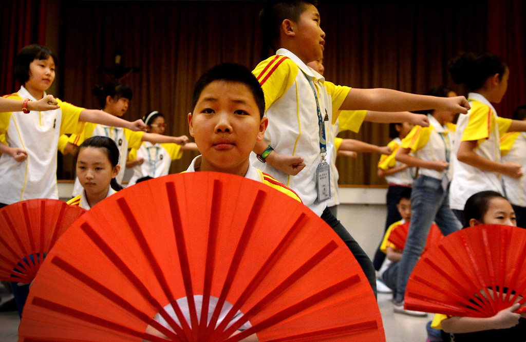 . Chinese fourth and fifth grade students from Harbin Normal University perform a dance as they visit Immaculate Conception Catholic School in Monrovia Wednesday, January 22, 2014. (Photo by Sarah Reingewirtz/Pasadena Star-News)