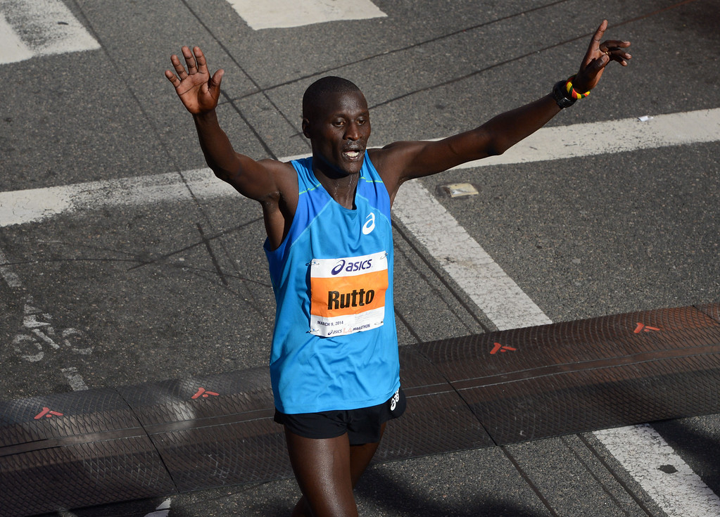. 2014 ASICS LA Marathon men\'s 2nd place winner Lani Rutto of Kenya,  crosses the finish line in Santa Monica Calif, with a time of 2: 10: 48.   Sunday, March 9,  2014.   (Photo by Stephen Carr / Daily Breeze)