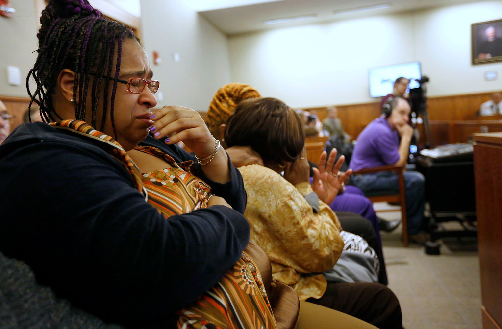 . Joanne Paul-Joassainte, left, is tearful during the murder trial for former New England Patriots football player Aaron Hernandez, Thursday, Jan. 29, 2015, in Fall River, Mass. Hernandez is charged with killing semiprofessional football player Odin Lloyd, 27, in June 2013.  Paul-Joassainte was sitting with Lloyd\'s mother Ursula Ward.  (AP Photo/Steven Senne, Pool)