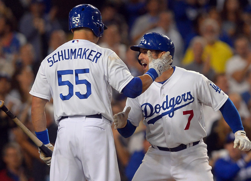 . Skip Schumaker congratulates Nick Punto after Punto\'s 7th inning homerun against the Mets August 12, 2013.  The Dodgers are hosting the Mets for a three game series.(Andy Holzman/Los Angeles Daily News)