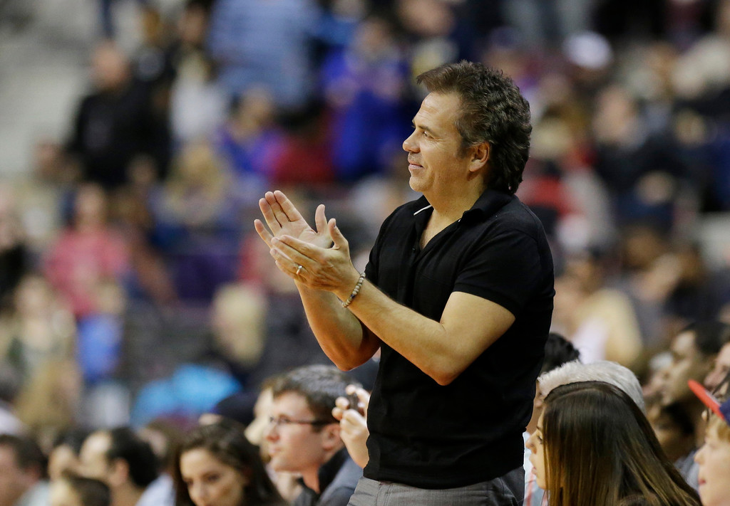 . Detroit Pistons owner Tom Gores watches from the sidelines during the second half of an NBA basketball game against the Los Angeles Lakers at the Palace in Auburn Hills, Mich., Friday, Nov. 29, 2013. (AP Photo/Carlos Osorio)