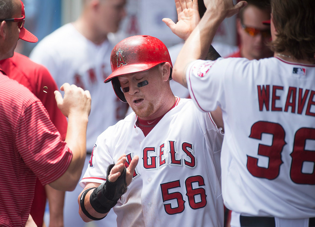 . Angels\' Kole Calhoun (#56) is congratulated after scoring against the Minnesota Twins at Angel Stadium in Anaheim on Thursday June 26, 2014. (Photo by Keith Durflinger/Whittier Daily News)