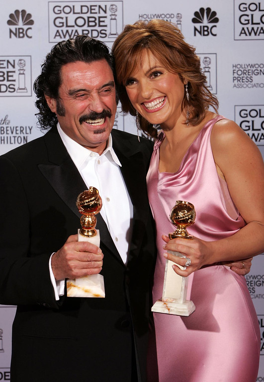 ". Mariska Hargitay poses with the award she won for best actress in a drama series for her work on ""Law & Order: Special Victims Unit,\"" right, and Ian McShane poses with the award he won for best actor in a drama series for his work on ?Deadwood,? at the 62nd Annual Golden Globe Awards on Sunday, Jan. 16, 2005, in Beverly Hills, Calif.  (AP Photo/Reed Saxon)"