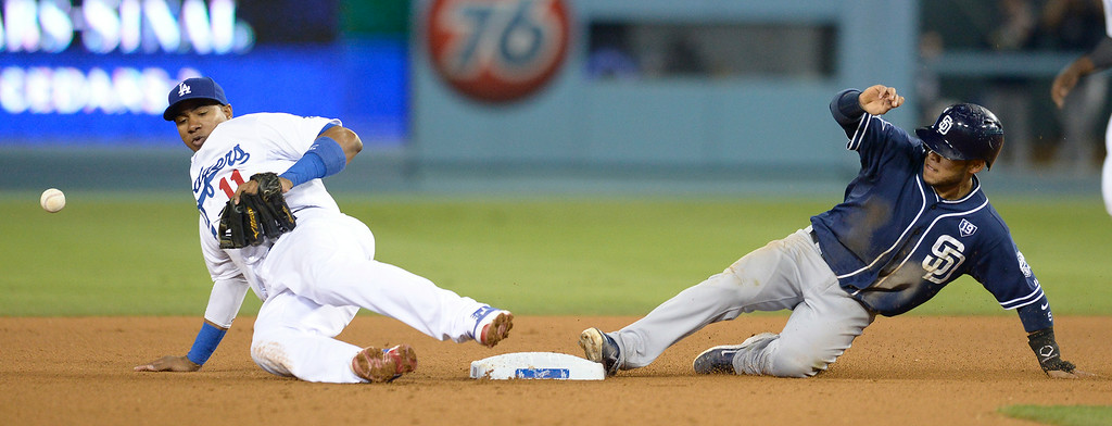 . Erisbel Arruebarrena can not handle the throw allowing Padres Alexi Amarista to steal 2nd base in the 8th inning. The Dodgers lost to the San Diego Padres 4-1 at Dodger Stadium. Los Angeles, CA. 8/20/2014(Photo by John McCoy Daily News)