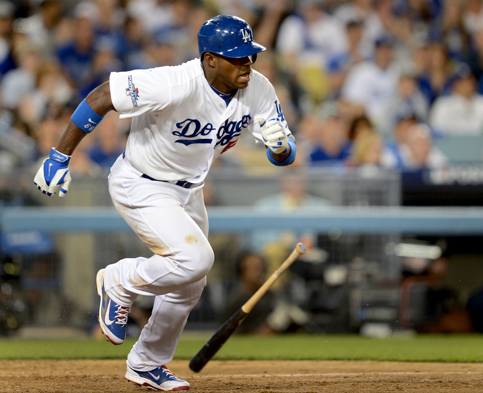 . Los Angeles Dodgers\' Yasiel Puig hits a base hit as they play the Atlanta Braves during game 3 against the Atlanta Braves of the NLDS at Dodger Stadium Sunday, October 6, 2013. (Photo by Hans Gutknecht/Los Angeles Daily News)