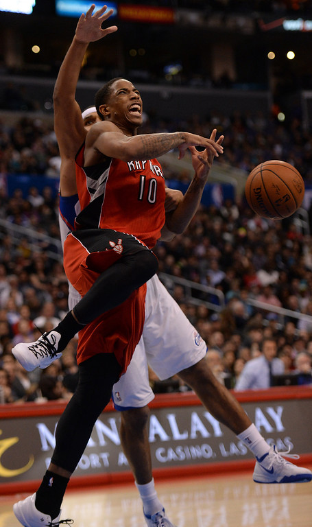 . The Raptors� DeMar DeRozan #10 can\'t hold on to the ball as the Clippers� Jared Dudley #9 defends during their game at the Staples Center in Los Angeles Friday, February 7, 2014. (Photo by Hans Gutknecht/Los Angeles Daily News)