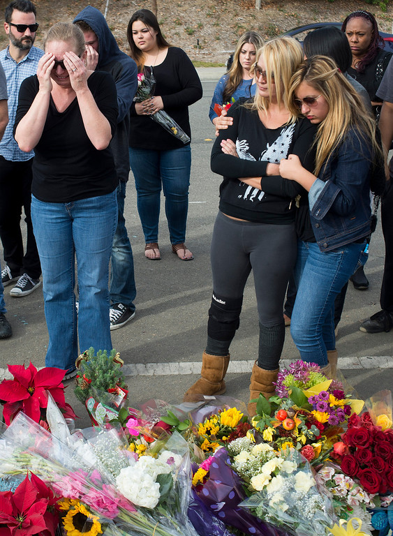 . Amie Kaz pays her respects at a memorial for her half brother actor Paul Walker who was killed on Saturday, November 30, 2013 in Valencia, Ca. Walker was in a 2005 Porsche Carrera GT, believed to be driven by his friend Roger Rodas, that crashed and burst in to flames killing both occupants. (Photo by Hans Gutknecht/Los Angeles Daily News)