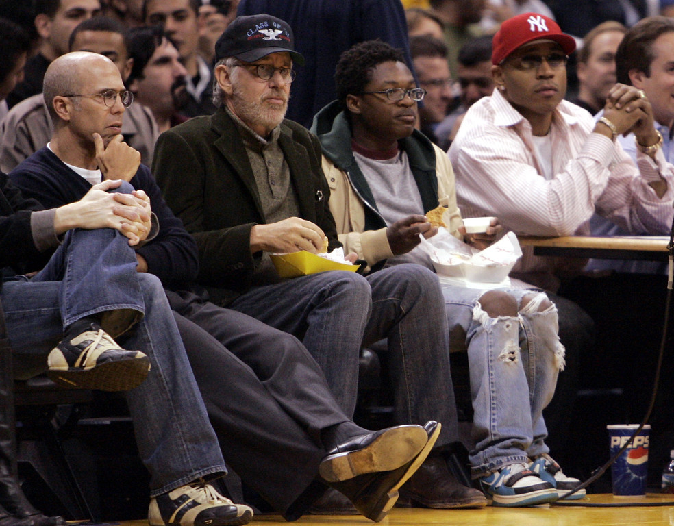. Jeffrey Katzenberg, left, Steven Spielberg, second to the left, and musician LL Cool J, right, watch the Los Angeles Lakers play the Philadelphia 76ers in Los Angeles, Friday, Jan. 6, 2006. The Lakers won 119-93. (AP Photo/Matt Sayles)