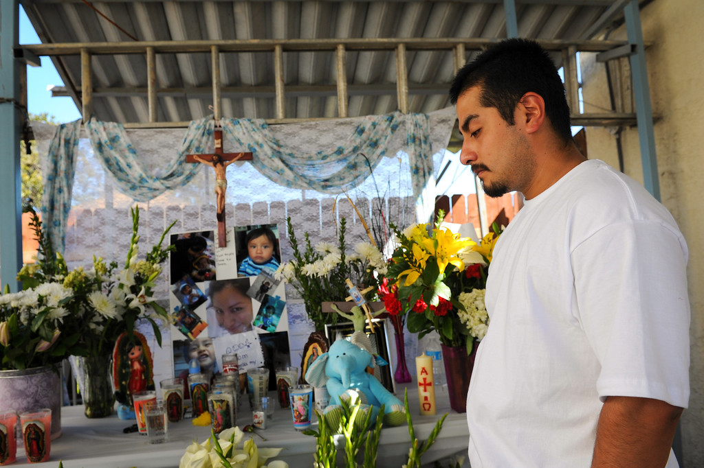 . Oscar Reyes mourns the deaths of his wife, Gissella Yauli, and 19-month-old son, Dillan Reyes, at a memorial at Oscar\'s brother\'s house in South Los Angeles, Monday, March 10, 2014. Their bodies were found in the burning garage of a South L.A. home, where the family had been living. (Photo by Michael Owen Baker/L.A. Daily News)