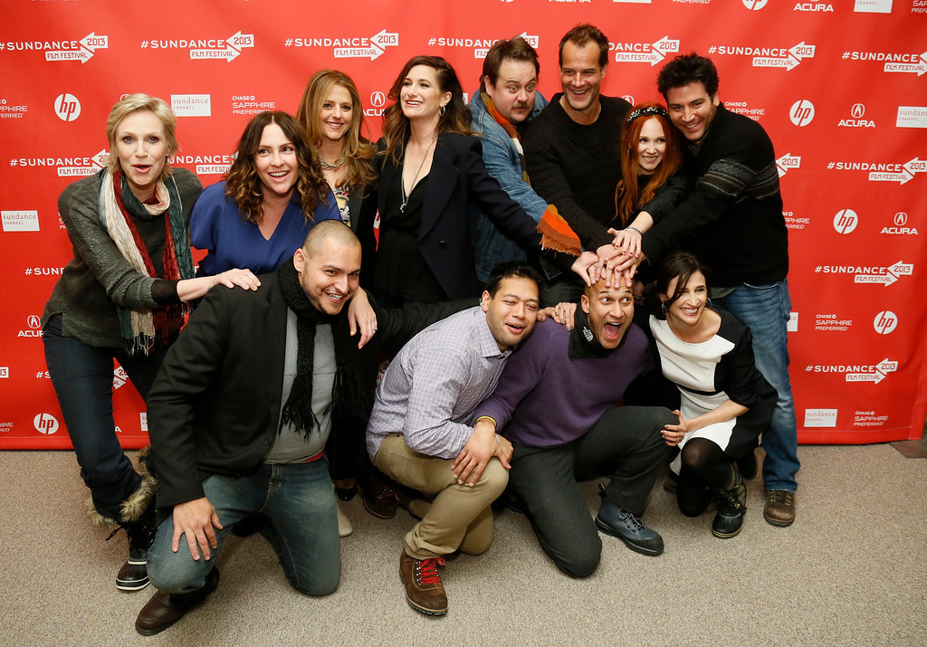 """. Cast members of \""""Afternoon Delight\"""" including, clockwise from top left, actress Jane Lynch, director Jill Soloway, actors Annie Mumolo, Kathryn Hahn, Noah Harpster, Josh Stamberg, Juno Temple, Josh Radnor, Michaela Watkins, Keegan Michael Key, Eugene Cordero, and Link Ruiz, pose together at the premiere during the 2013 Sundance Film Festival on Monday, Jan. 21, 2013 in Park City, Utah. (Photo by Danny Moloshok/Invision/AP)"""