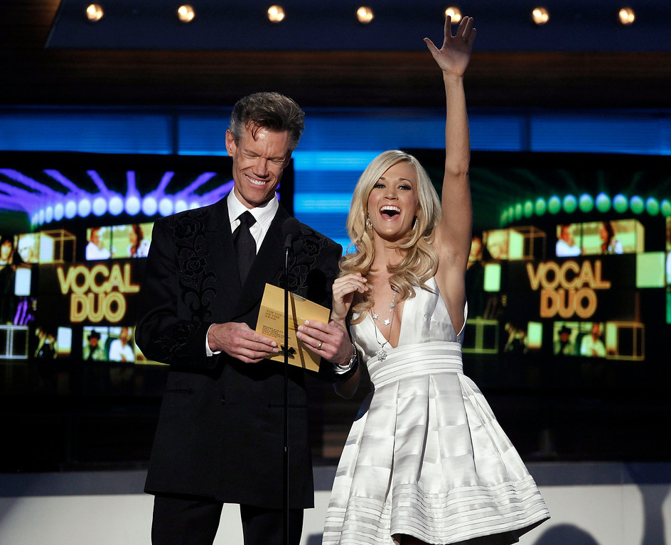 . Randy Travis, left, and Carrie Underwood present the award for best vocal duo at the 45th Annual Academy of Country Music Awards in Las Vegas on Sunday, April 18, 2010.  (AP Photo/Matt Sayles)