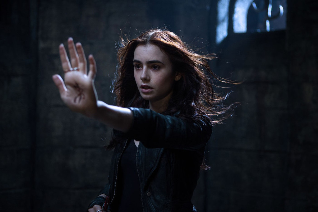 """. \""""The Mortal Instruments: City of Bones,\"""" out Aug. 21, stars Lily Collins who discovers she\'s a demon-fighting half-angel."""