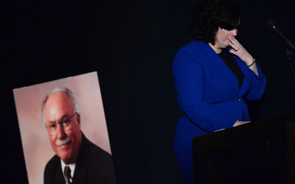 . Shawna Tennant takes a moment as she speaks about her father during a celebration of life service for former Pasadena Fire dept. Capt. and California State fire marshall, John Tennant at the Pasadena Civic Auditorium in Pasadena, Calif., on Wednesday, Feb. 5, 2014. (Keith Birmingham Pasadena Star-News)