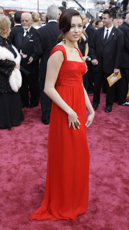 . Miley Cyrus arrives at the 80th Academy Awards at the Kodak Theatre in Los Angeles, Sunday, Feb. 24, 2008. (AP Photo/Chris Carlson)