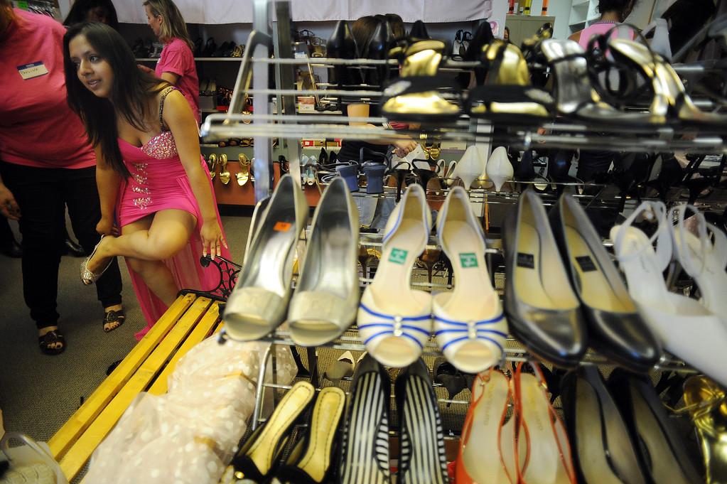 . Gladys Ortiz, 17, tries on shoes at the Assistance League of Los Angeles in Hollywood Thursday, March 6, 2014. Operation School Bell Prom Day program outfitted 56 low-income and homeless high school girls from 17 LAUSD schools with dresses, shoes and other accessories so they can attend their proms.(Photo by Hans Gutknecht/Los Angeles Daily News)