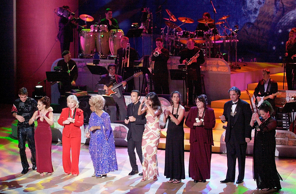 . WASHINGTON, UNITED STATES:  (From L-R) Singer Carlos Ponce, Gloria Estefan, Hispanic Heritage Award Winner Cristina Saralegui, salsa queen Celia Cruz, Francesco Quinn, model Patricia Velasquez, Hispanic Heritage Award Winners Mary Joe Fernandez, Judith Baca, Gregory Nava and Liz Balmaseda dance 25 August 2001 during the finale of the 2001 Hispanic Heritage Awards held at the Kennedy Center in Washington, DC.  (SHAWN THEW/AFP/Getty Images)