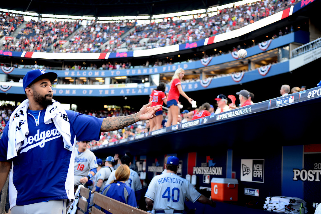 . Los Angeles Dodgers\' Matt Kemp throws back a signed ball in the dugout during game 2 of the playoffs Thursday, October 4, 2013 at Turner Field in Atlanta, Georgia. Braves defeated the Dodger 4-3. (Photo by Sarah Reingewirtz/Pasadena Star- News)