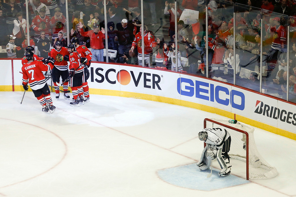 . Los Angeles Kings goalie Jonathan Quick (32) reacts as the Chicago Blackhawks celebrate after scoring a goal during the second period in Game 2 of the NHL hockey Stanley Cup Western Conference finals Sunday, June 2, 2013 in Chicago. (AP Photo/Charles Rex Arbogast)