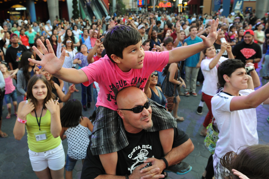 . Nidal Amro, of Mississippi, and his son Adam Amro, 6, have fun during a DJ performance at 5 Towers at Universal CityWalk. Friday, July 6, 2013. (Michael Owen Baker/L.A. Daily News)
