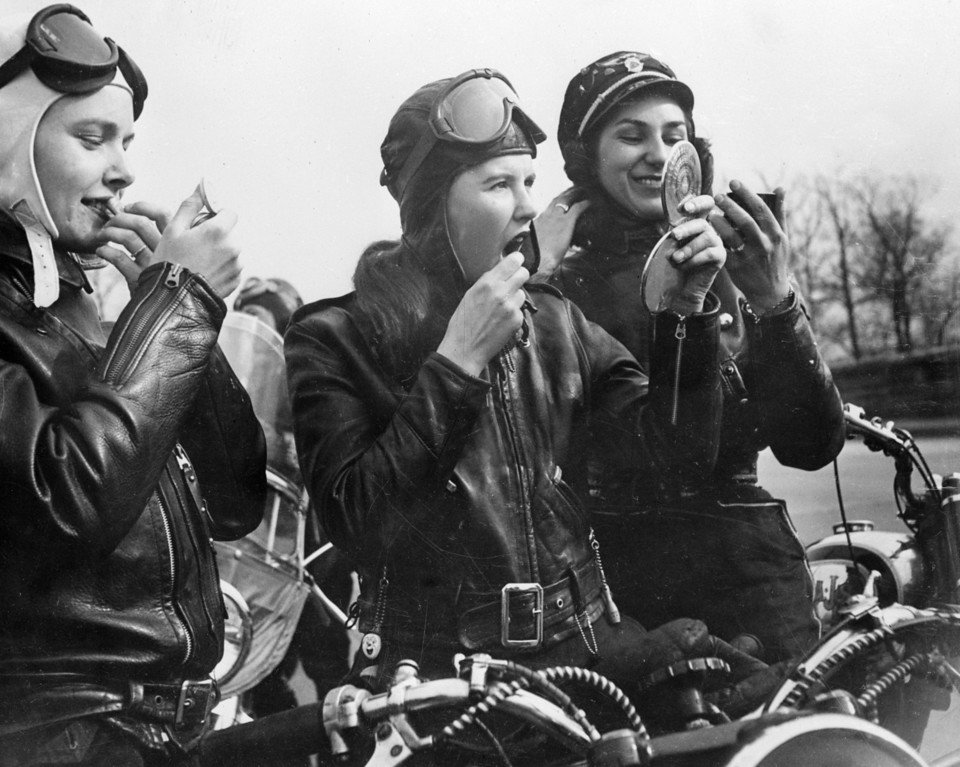 . February 1950:  Bikers Marian Willgoes, Joan Nimlo and Gloria Crane reapply their make up during a meeting of their all female motorbike club in Queens, New York.  (Photo by Keystone Features/Getty Images)