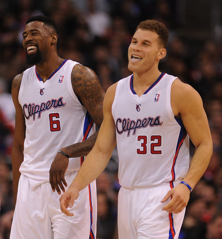 . Clippers� DeAndre Jordan #6 and Blake Griffin #32 are all smile after taking a big lead over the Raptors in the first half during their game at the Staples Center in Los Angeles Friday, February 7, 2014. (Photo by Hans Gutknecht/Los Angeles Daily News)