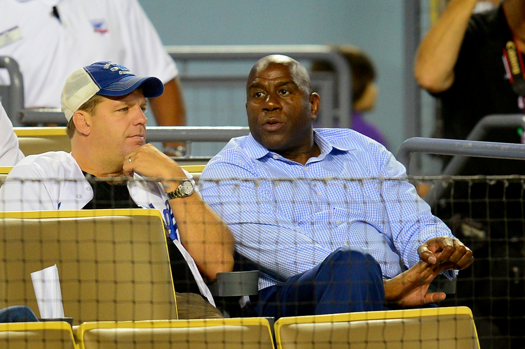 . Magic Johnson watches the Dodgers-Mets. (Photo by Michael Owen Baker/Los Angeles Daily News)