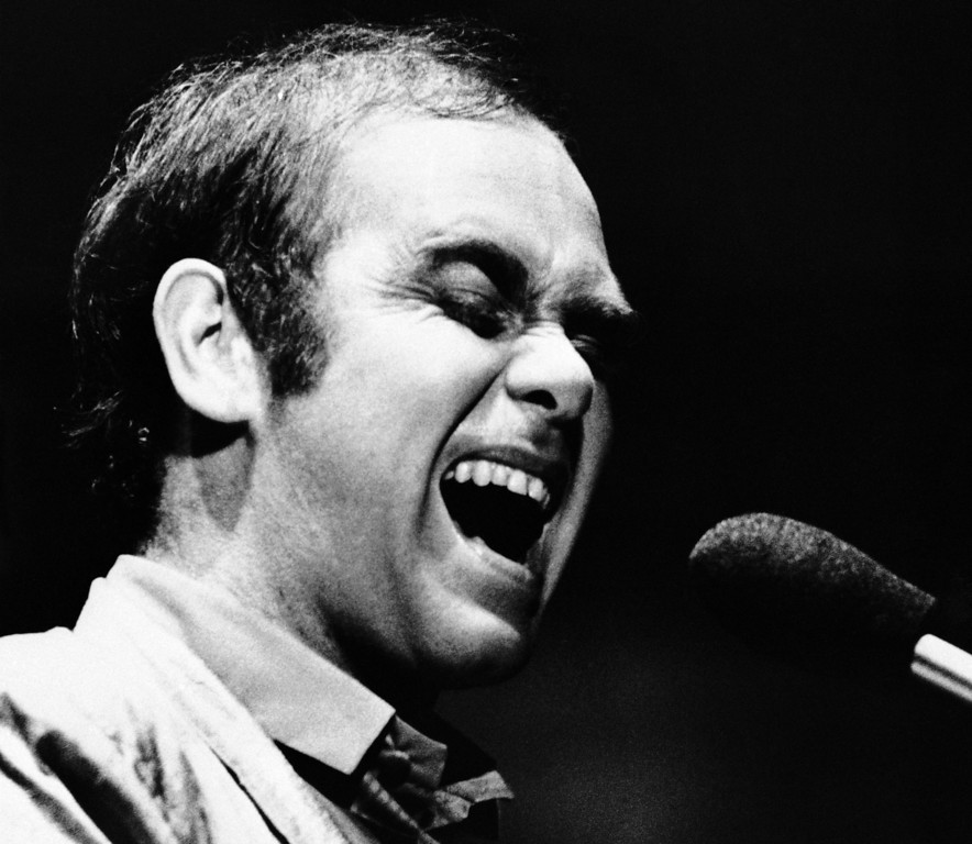 . Singer Elton John, sporting his new hair transplant, performs at the Universal Amphitheatre in Los Angeles, Sept. 27, 1979. (AP Photo/Joan Adlen)