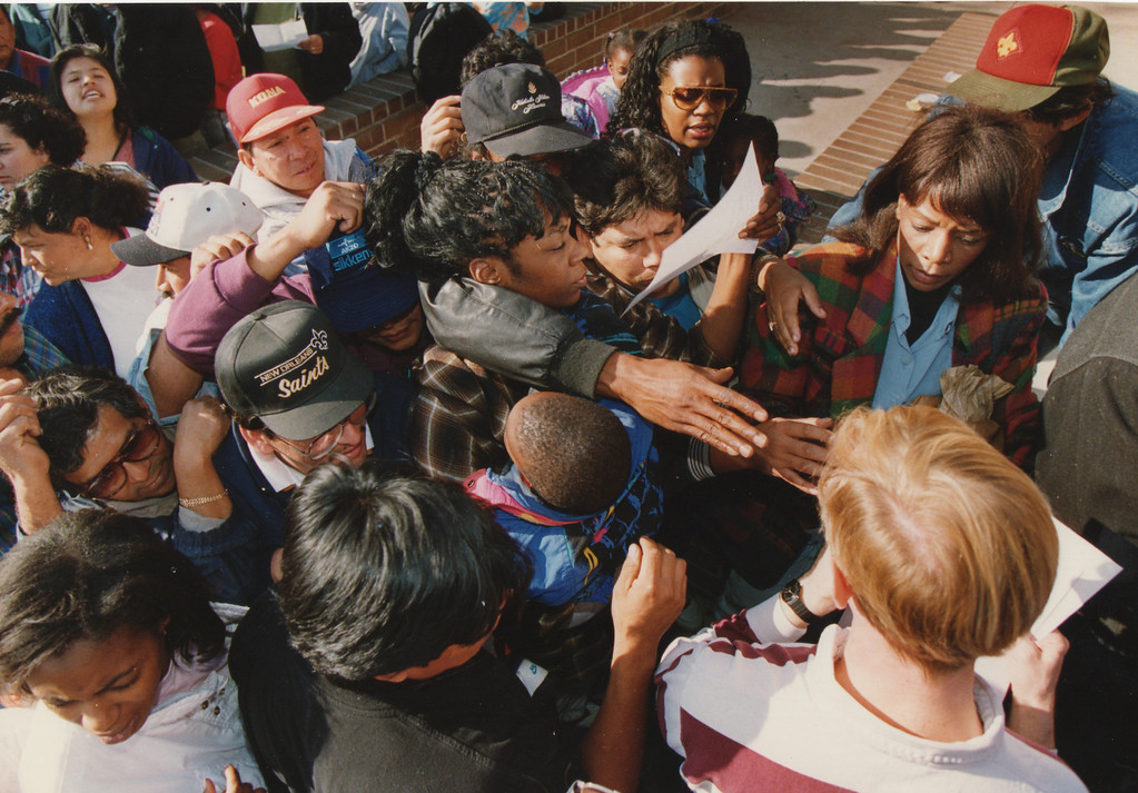 . People reach for donated food at Lanark Park in Canoga Park, CA. 1/17/1994, photo by (John McCoy/Los Angeles Daily News)