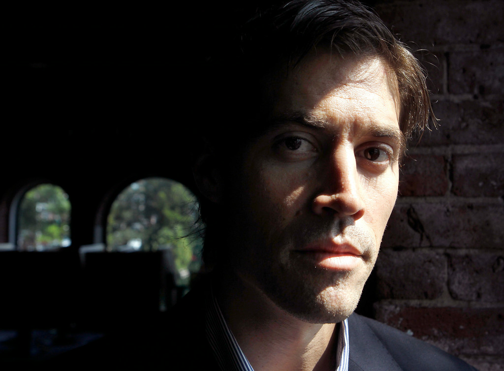 . In this May 27, 2011 file photo American Journalist James Foley, of Rochester, N.H., poses for a photo in Boston.  (AP Photo/Steven Senne, File)