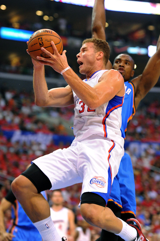 . The Clippers\' Blake Griffin goes to the basket against the Thunders\' Serge Ibaka in game six of the Western Conference semifinals, Thursday, May 15, 2014, at Staples Center. (Photo by Michael Owen Baker/Los Angeles Daily News)