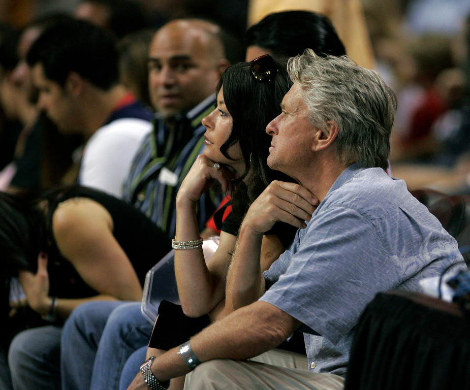 . Actors Catherine Zeta Jones, second from right, and husband, Michael Douglas, right, watch the basketball game in   Miami, Friday, April 13, 2007, between the Indiana Pacers and Miami Heat.   (AP Photo/J. Pat Carter)