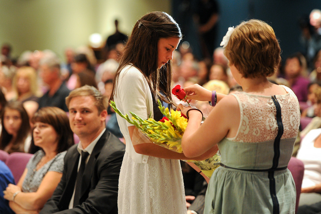 . Kristen Swales, left, and Emily Wagner hand out roses during a prayer vigil at West Valley Christian School, Thursday, July 11, 2013, in honor of the crash victims of Asiana Flight 214 airliner that crashed at San Francisco Airport. (Michael Owen Baker/L.A. Daily News)