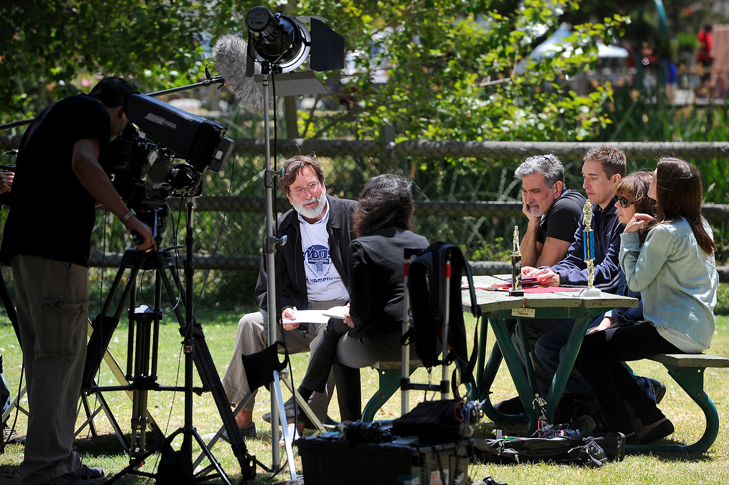 . Richard Martinez, left, the father of slain student Christopher Martinez, is interviewed with family in a park in Isla Vista, Sunday, May 25, 2014. (Photo by Michael Owen Baker/Los Angeles Daily News)