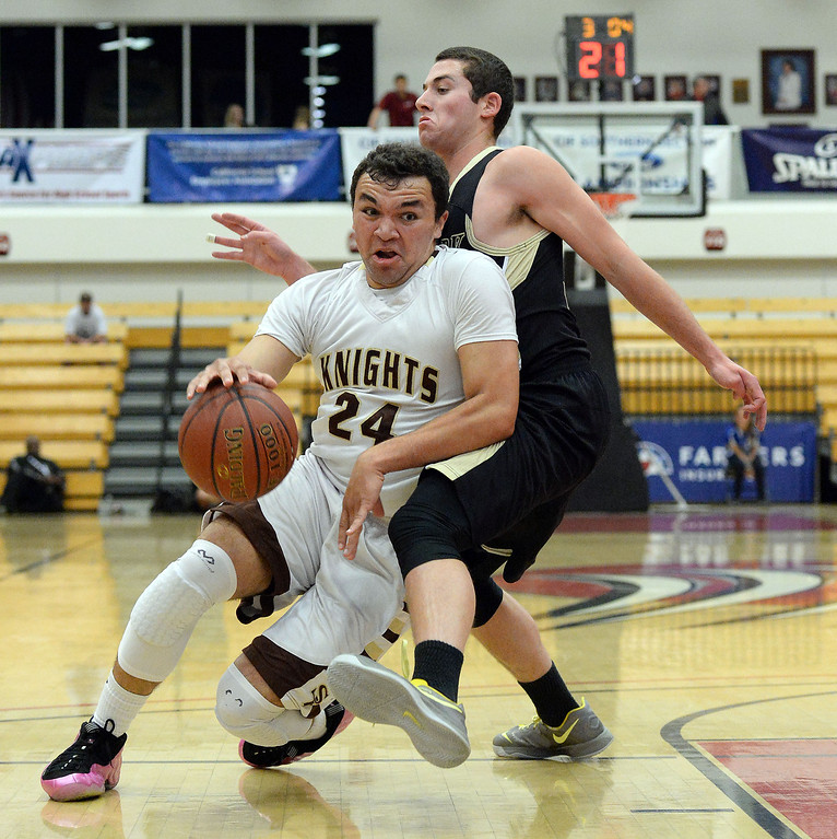 . St. Francis\' Noah Willerford (24) falls to floor as he his fouled by Oak Park\'s Matt Byer (33) in the first half of a CIF-SS Division 3A Championship basketball game at the Felix Event Center on the campus of Azusa Pacific University in Azusa, Calif., on Friday, March 7, 2014. (Keith Birmingham Pasadena Star-News)