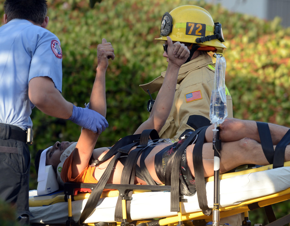 . A 20 year old man gives a thumbs up after being rescued by San Bernardino County Firefighters from being crushed by 2000 pounds of granite in a trailer at a contractors business in Fontana April 30, 2013.(Thomas R. Cordova/Staff Photographer)