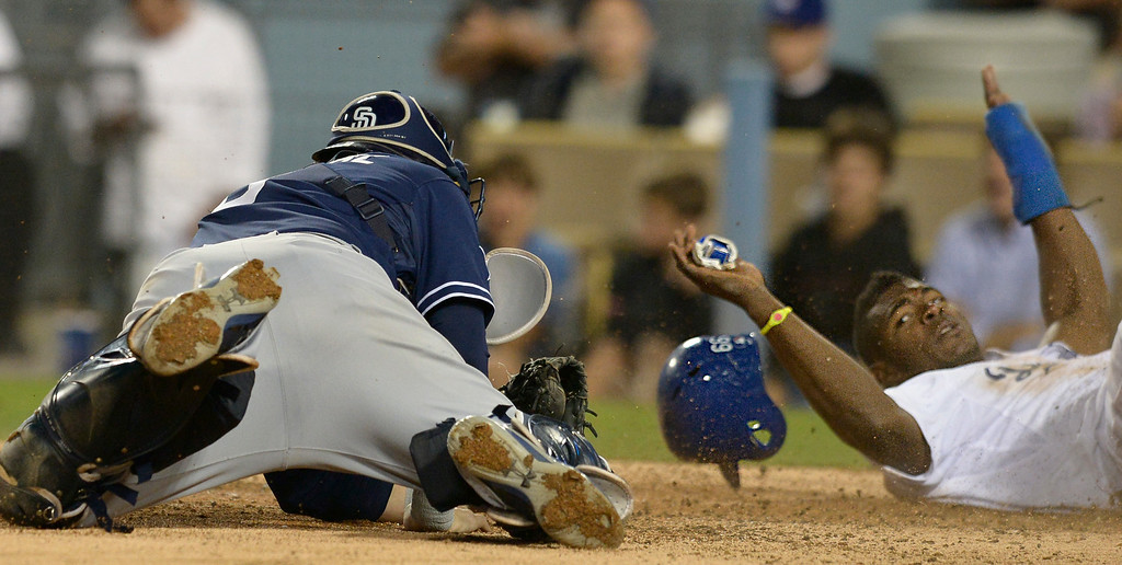 . Padres catcher Yasmani Grandal can not catch Yasiel Puig at the plate in the 3rd inning. The Dodgers played the San Diego Padres at Dodger Stadium. Los Angeles, CA. 8/20/2014(Photo by John McCoy Daily News)